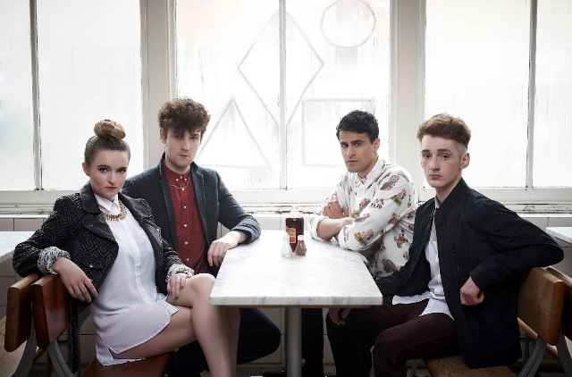 Apparently not hungry, Clean Bandit stares into camera while possibly waiting for food.