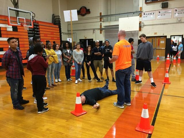 Students participate in CPR simulation, photo courtesy of Justin Wexler