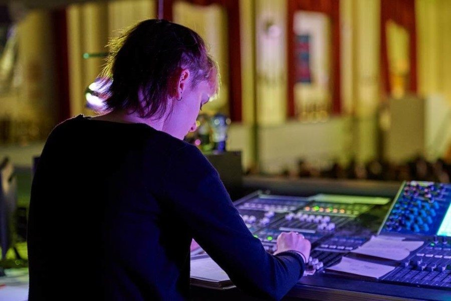 Junior Sophie Lyons working the sound booth at a drama club rehearsal. Photo courtesy of Scott Drynan.
