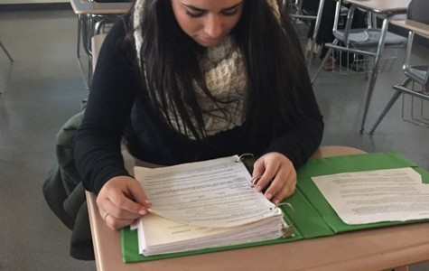 In this staged photo, junior Maddie Santora reviews her notes for AP Language