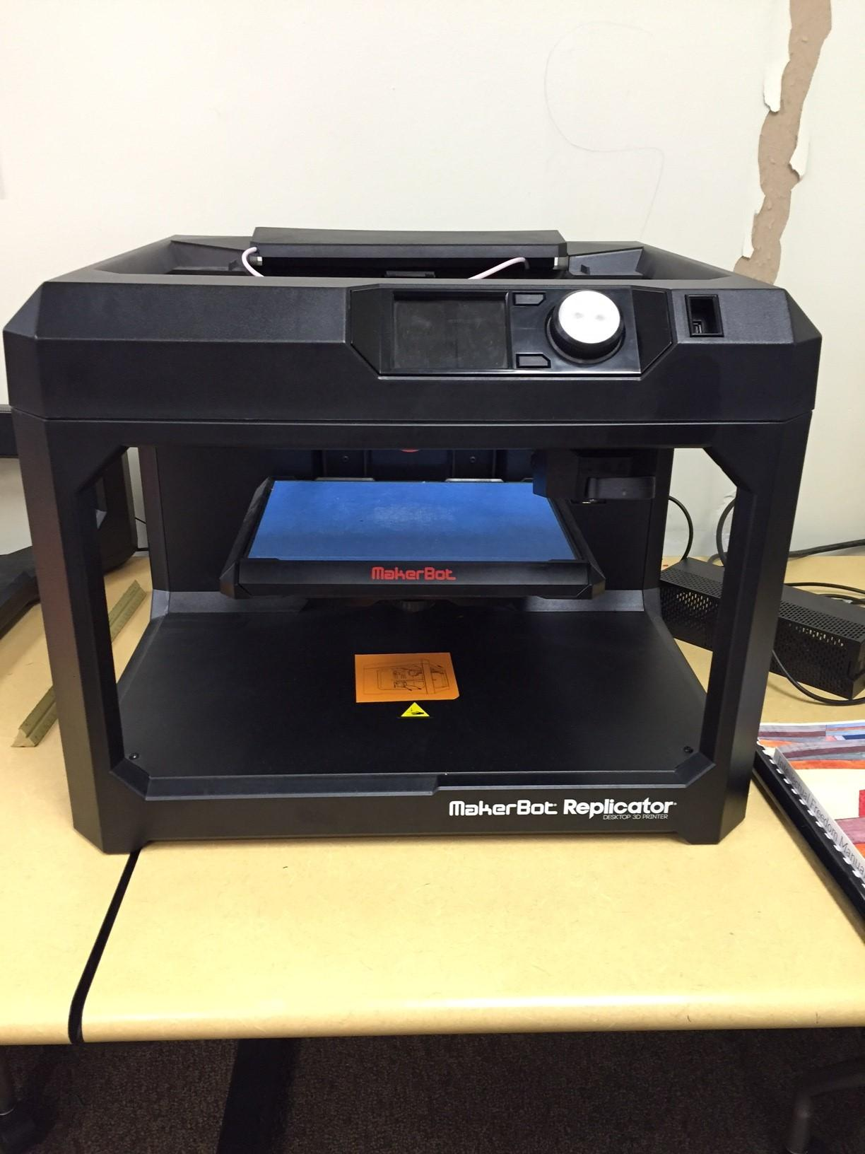 Shown above is the Maker Bot 3D printer machine in the displayed in the media center