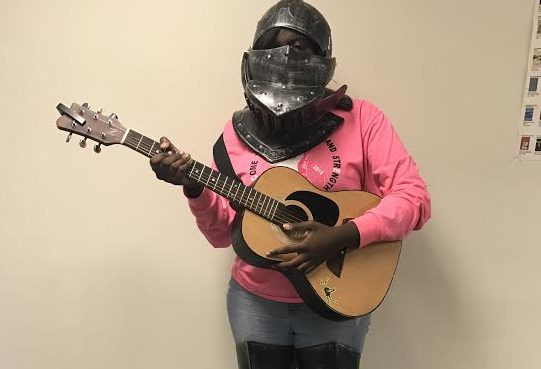 Junior Amani Nasheed models a knight costume and guitar for Halloween. (Reminder: masks and/or head coverings are not permitted in school on Halloween)
