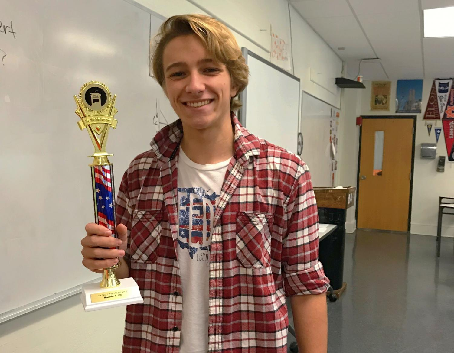 Doricko proudly posing with his First Place Speaker Trophy from the November 11 Tournament.