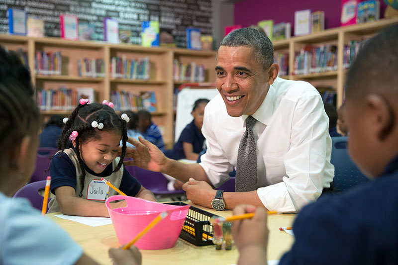 President Barack Obama participates in a literacy lesson with children while visiting a pre-kindergarten classroom at Moravia Elementary School in Baltimore, Md., May 17, 2013. (Official White House Photo by Pete Souza)
