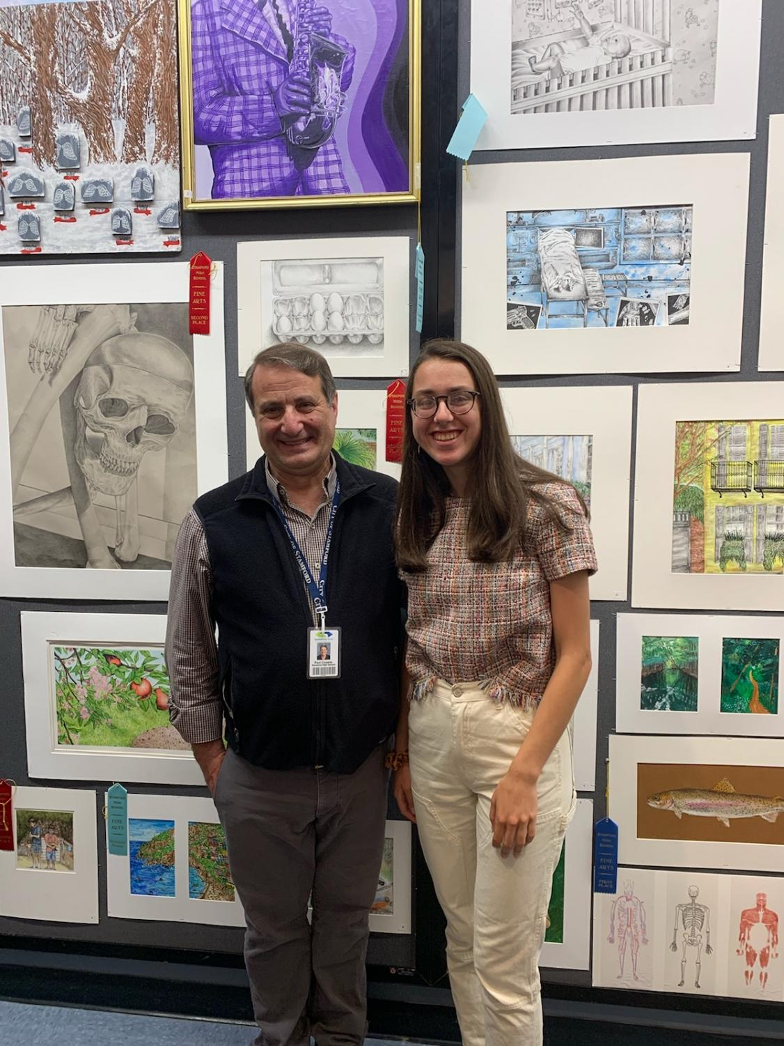 Mr. Cusano with student, Ivy Zingone infront of artwork.