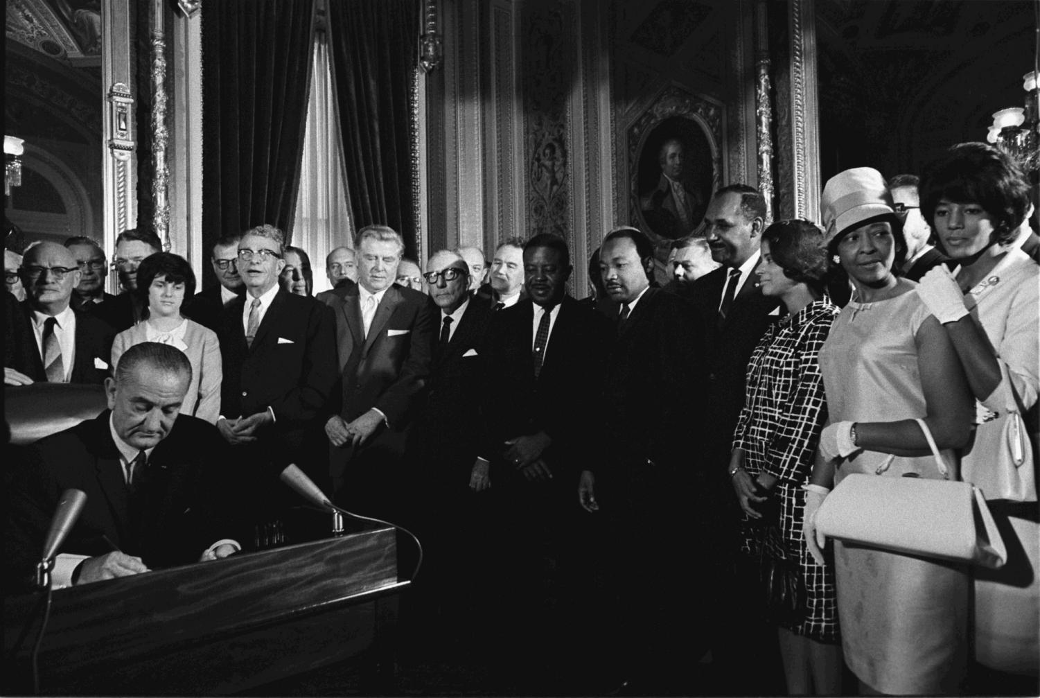 President Lyndon B. Johnson signs Voting Rights Act of 1965