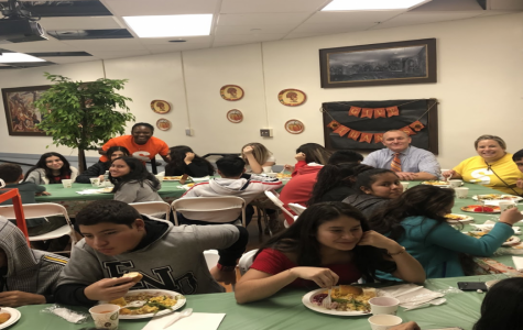 Stamford High School students enjoy dinner at Stamford High School's First Thanksgiving on November 27, 2019.