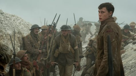"Schofield (George MacKay, foreground) with fellow soldiers in ""1917,"" the new epic from Oscar®-winning filmmaker Sam Mendes."