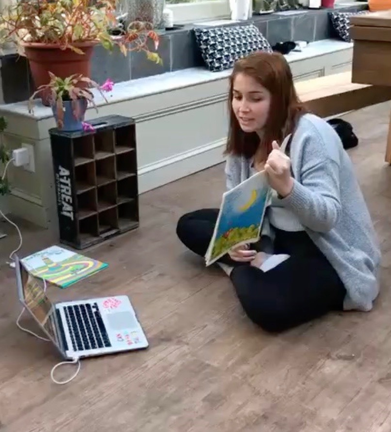 MYLC member Emma Valerio reads with a student online.