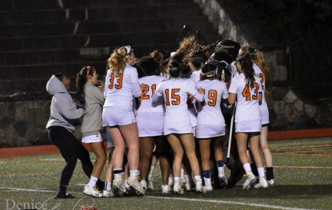 The Girls lacrosse team celebrates after their victory against Westhill in the City Championship.