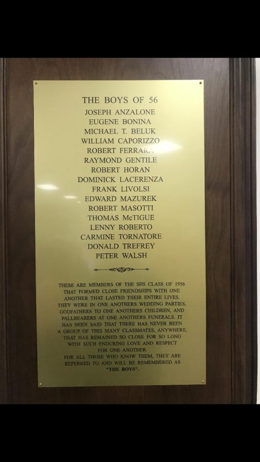 The plaque hanging in the front lobby of the school