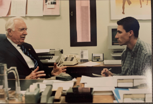 A younger Passamano speaks to journalism icon Walter Cronkite at Arizona State University.