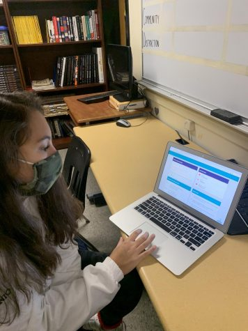 Stamford high senior working on her college applications in class.