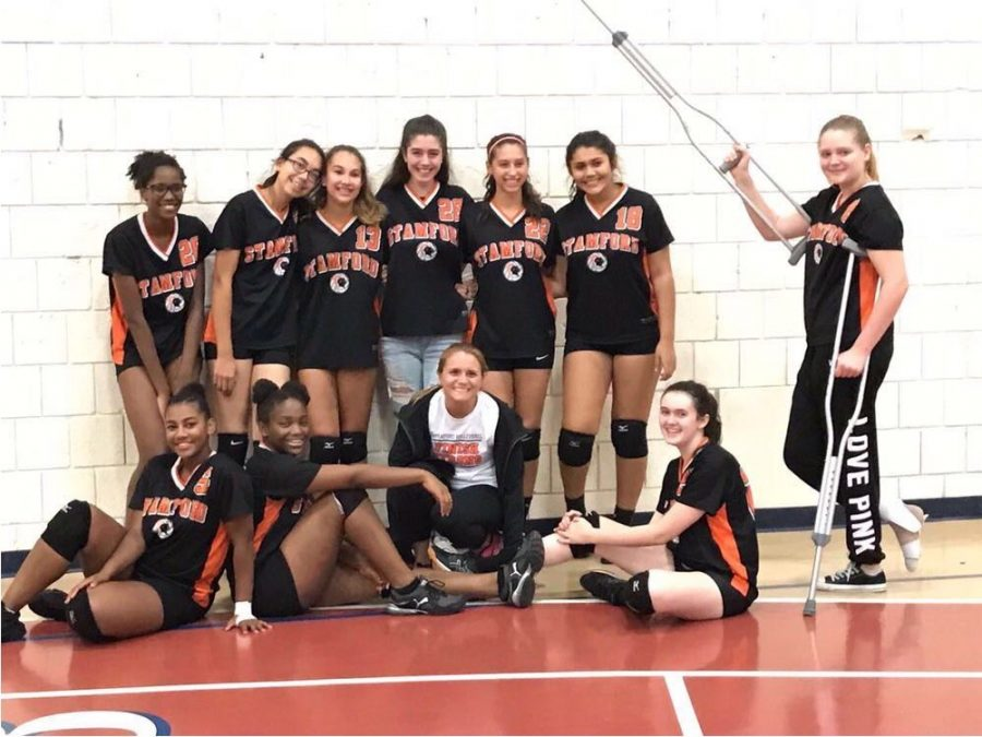 The author of the article as pictured (bottom row 1st student from left) with her teammates from the 2017 Freshman Girls Volleyball Team