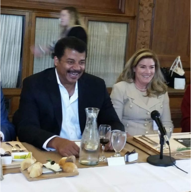 Dougherty with Neil deGrasse Tyson at Manhattanville College in Purchase, N.Y.