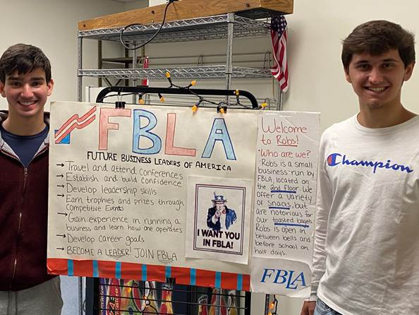 Edward Yudelovich and Zachary Tusa pose with a poseter they created for FBLA