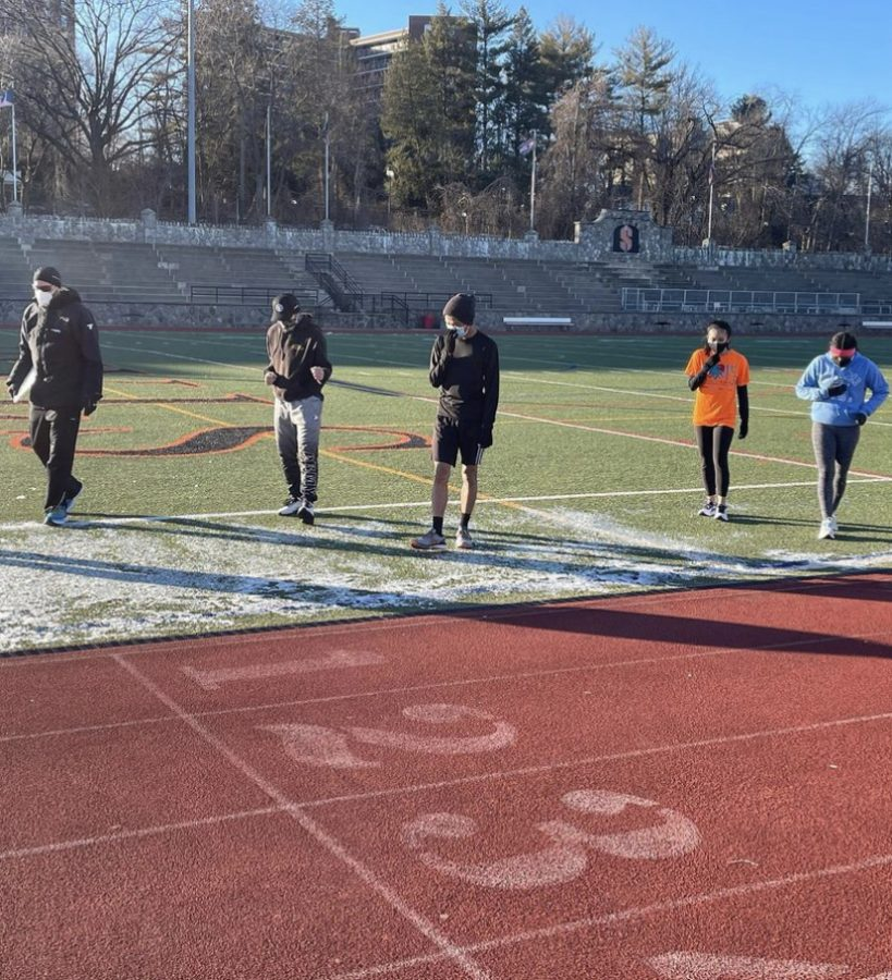 Stamford High Indoor Track pushes through cold weather conditions during practice.