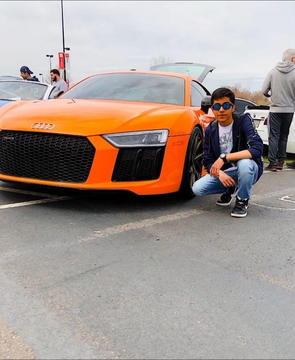 Faizan poses with his favorite car.